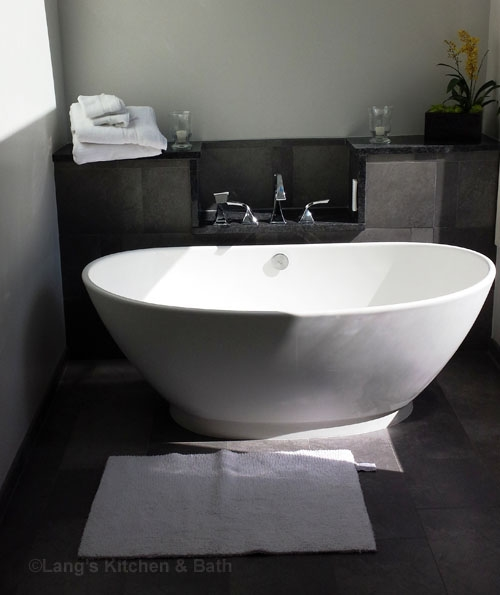 Transitional bathroom design with a sleek, modern tub and fixtures.