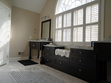 Master bath design with black vanity