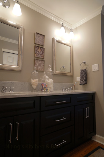 Bathroom design with Carrera marble countertop and black finish vanity.