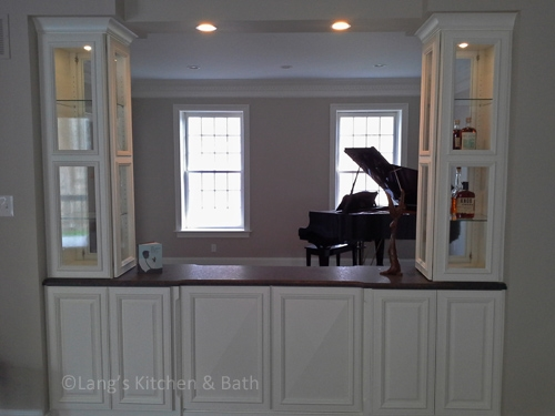 Beverage bar perfect for the bourbon connoisseur open to both living room and piano room.