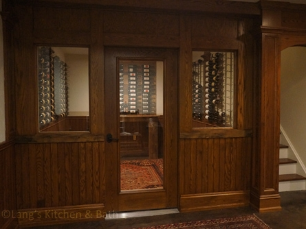 Wine cellar with a Breezaire refrigeration unit and built in wine racks.