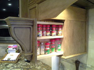 Kitchen design with pull out spice storage.