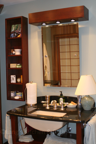 Bathroom design with an open vanity and open wall-mounted shelves.