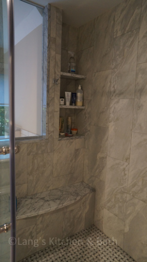 Shower with built in storage shelves