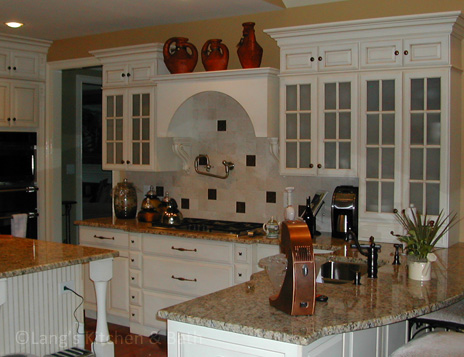 Kitchen design with pot filler.