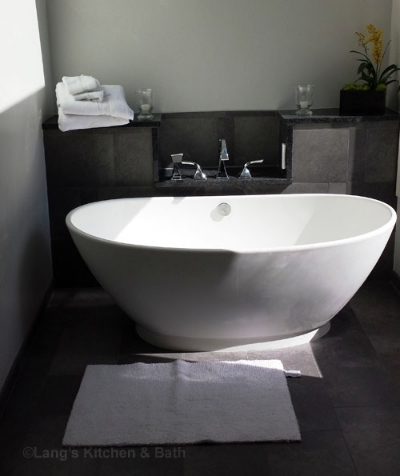 Freestanding tub with faucet coming from the wall.