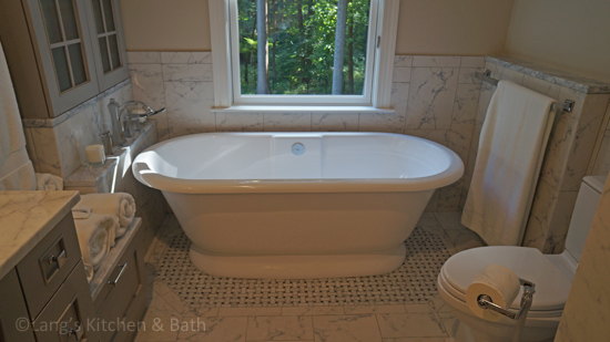 Bathroom design featuring a freestanding tub.