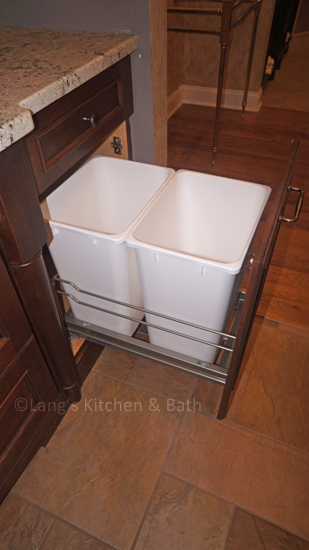 Kitchen cabinet with double trash pull out.