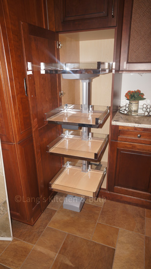 Kitchen design with a pantry equipped with pull out shelves.