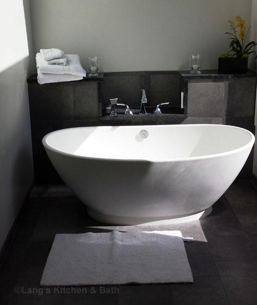 Bathroom design with a freestanding tub.