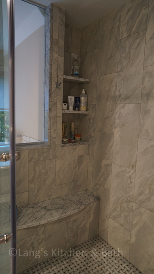 Master bathroom design with a shower seat