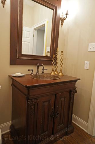 Glamorous powder room design.