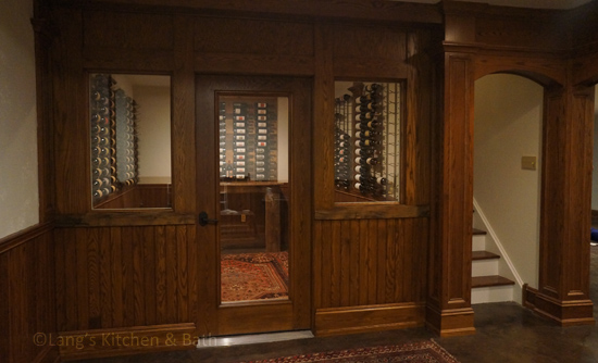 Wine cellar with wine storage and reclaimed barn wood table.