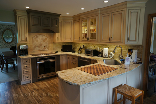 Farmhouse style kitchen design with distressed cabinetry.