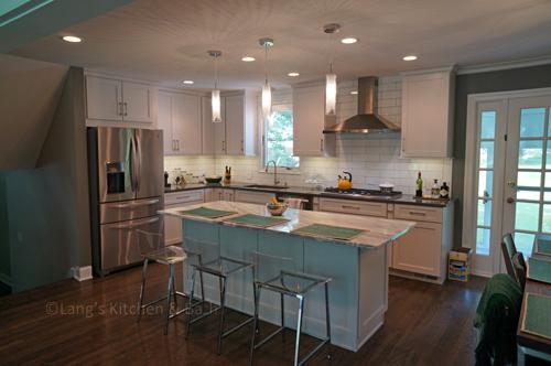 White shaker style kitchen design.