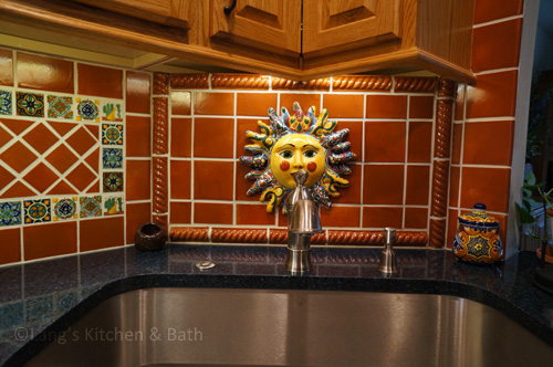 Southwestern style kitchen design with terracotta tiles.