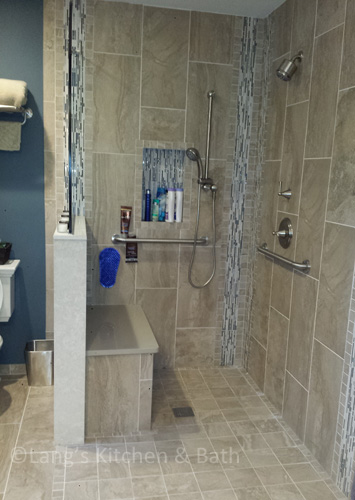 Accessible bathroom design with open shower and grab bars.
