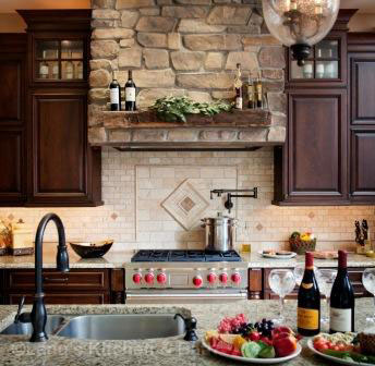 Luxury kitchen remodel with a custom stone hood.