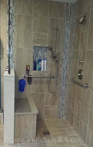 Accessible bathroom design with open shower.