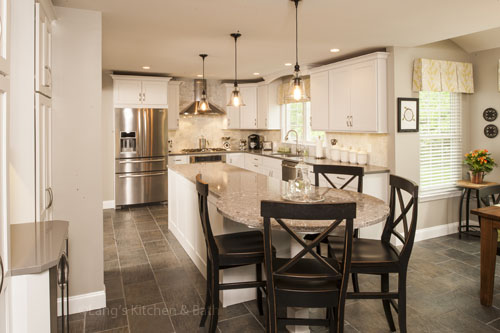 Kitchen design with customized island and seating.