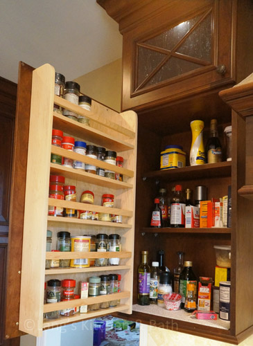 Kitchen design with spice storage.
