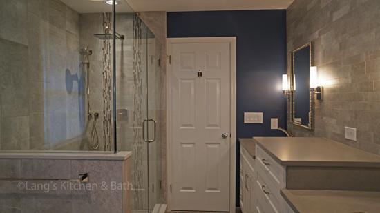 Bathroom design with large glass shower enclosure.