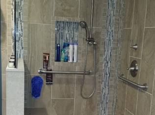 Bathroom design with shower rails
