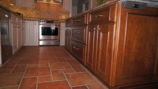 Kitchen design with textured tile floor