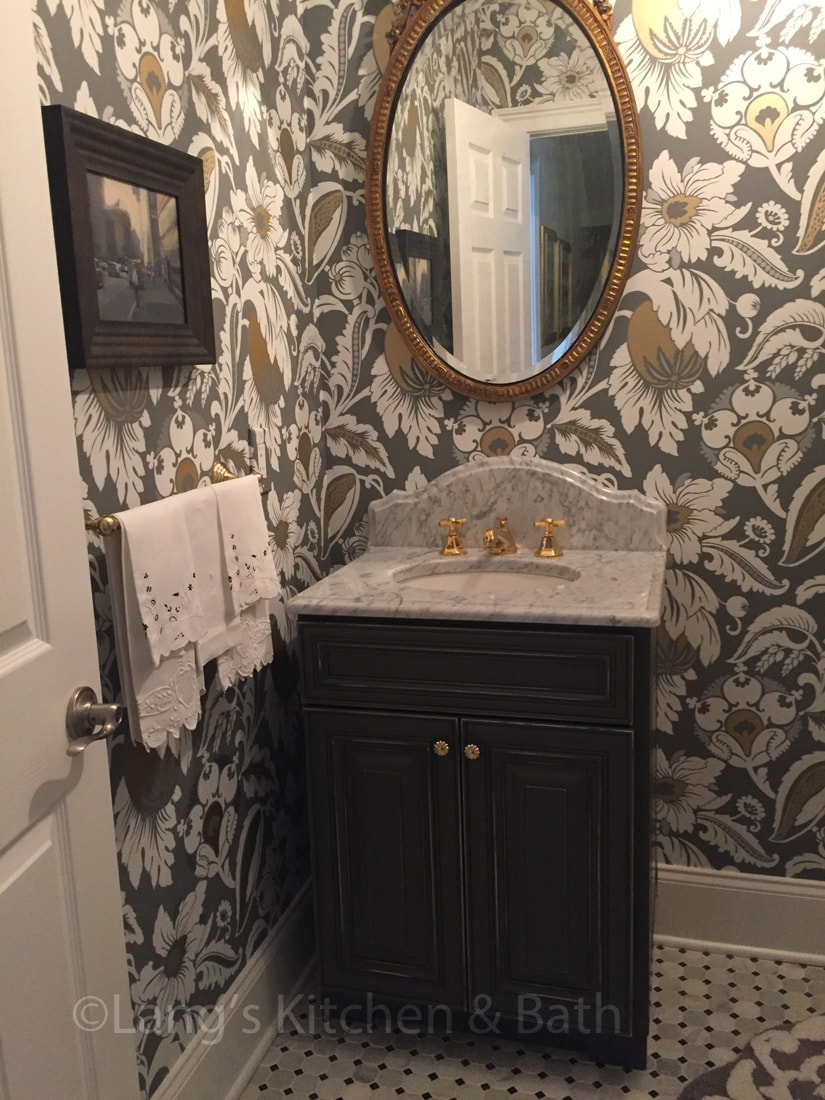 Powder room design with distressed finish vanity cabinet