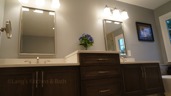 Bathroom design with sconce lights.