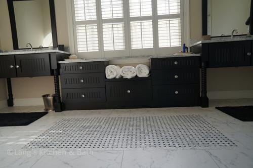 Bathroom design with basketweave tile floor.