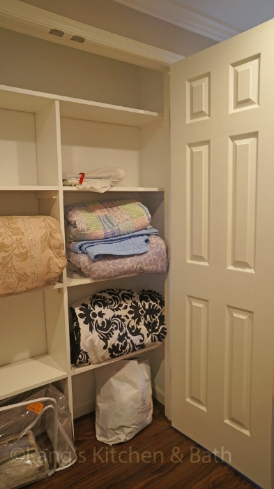 bathroom design with linen closet