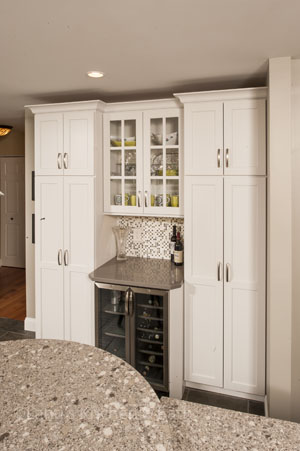 Kitchen design with upper cabinet for glassware