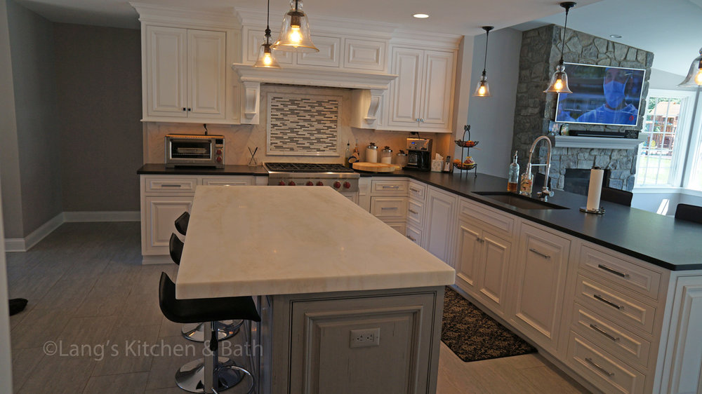 Kitchen design with island seating and television