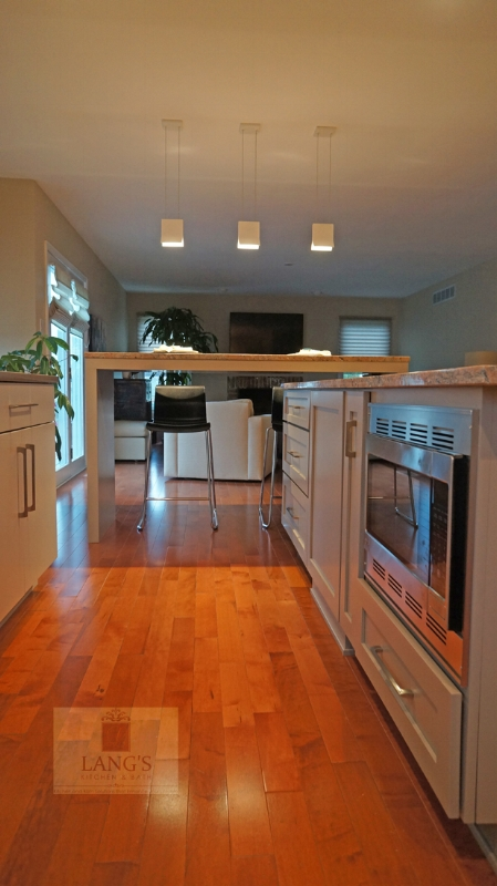 Kitchen design with wood flooring