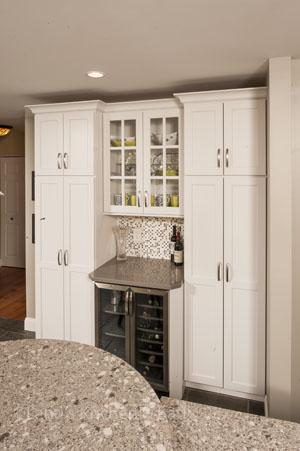 White kitchen design with beverage bar