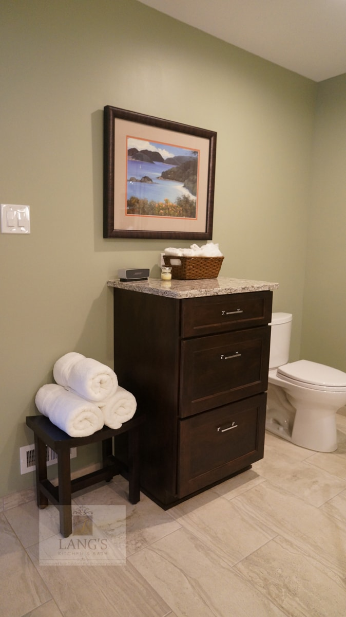 Master bath design with dark wood cabinetry