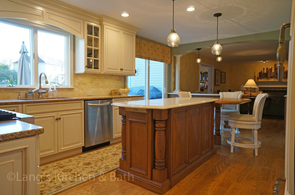 Open plan kitchen with hardwood floors