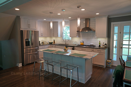 White shaker kitchen with hardwood floors