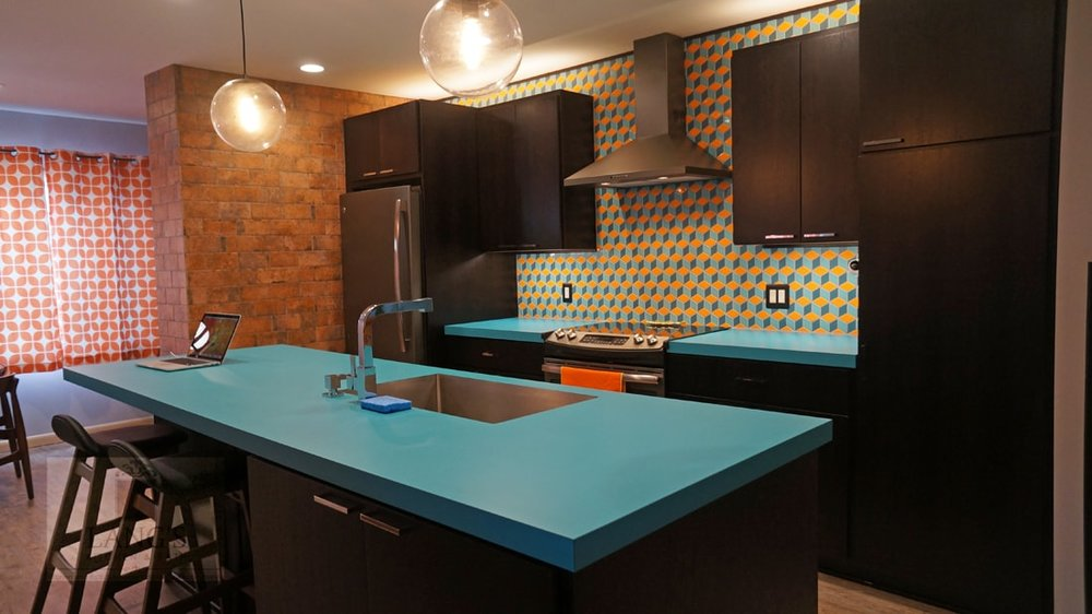 Kitchen design with bright color scheme