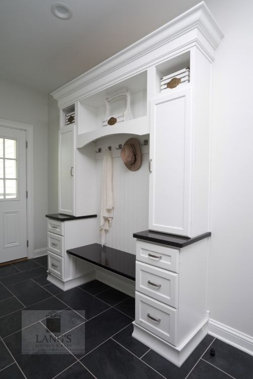 Mudroom design adjacent to kitchen design