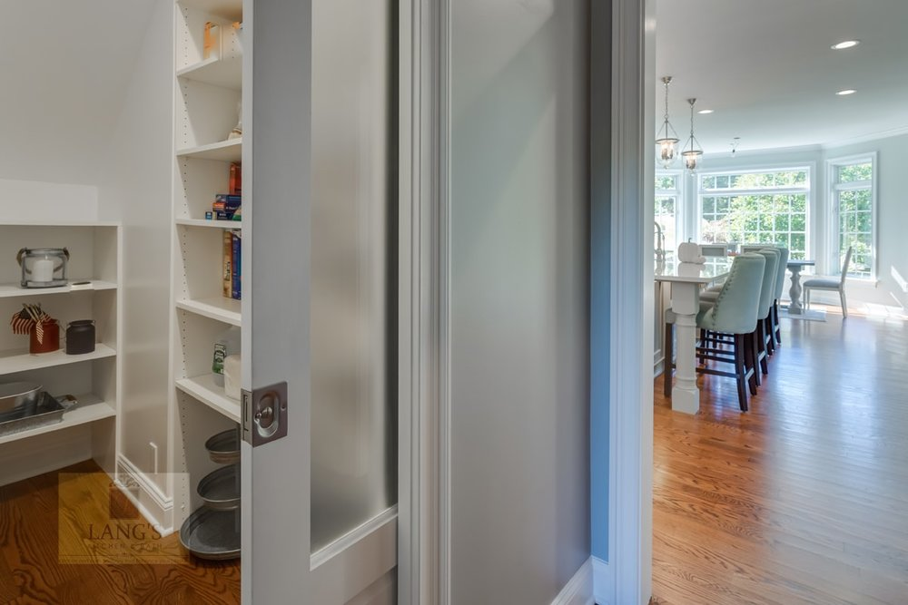 Kitchen design with adjacent pantry