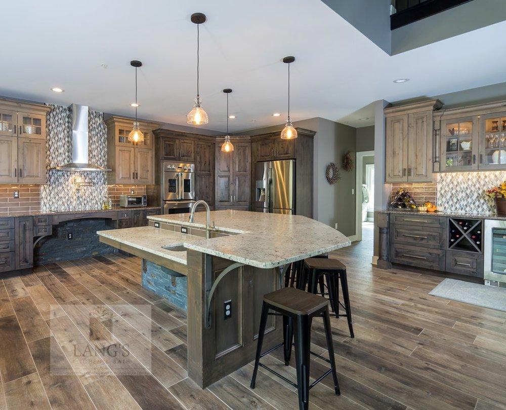 Open plan kitchen design with beverage bar