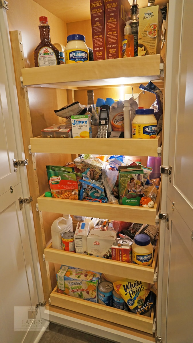 Kitchen pantry cabinet with roll out shelves