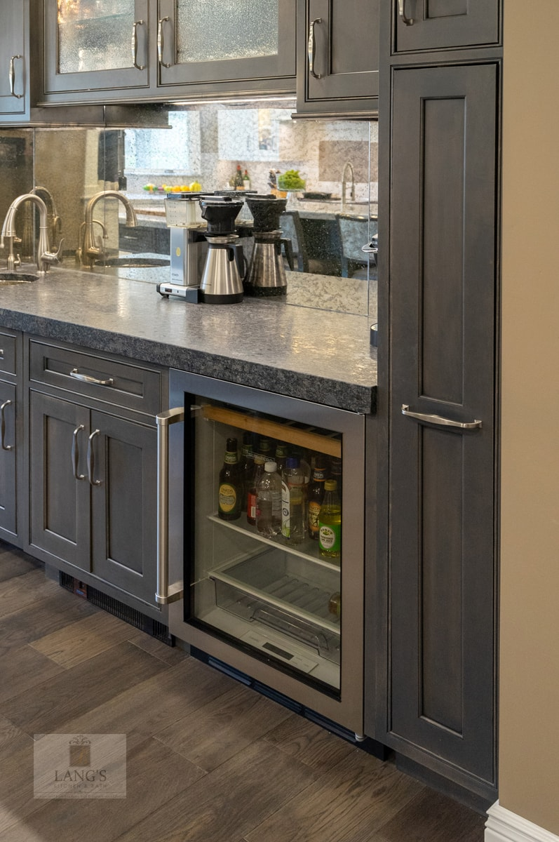 beverage bar with glass front cabinets