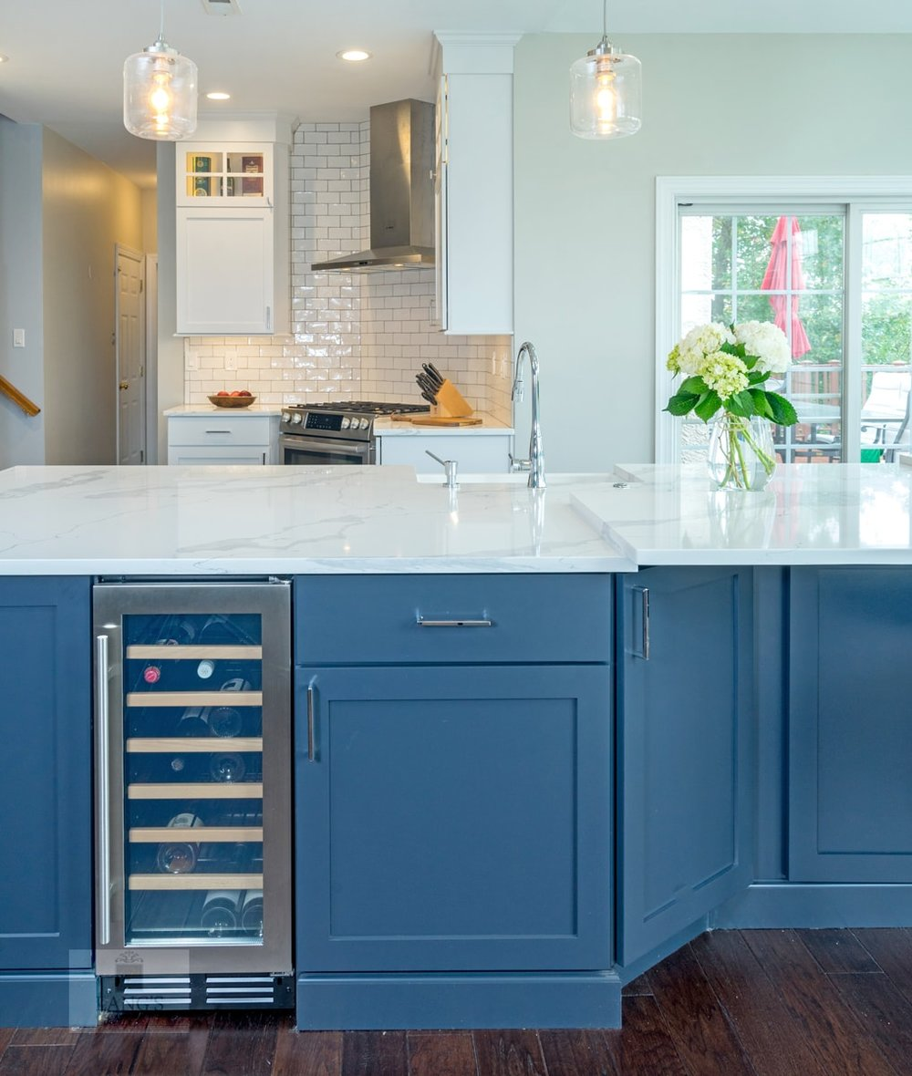 blue kitchen island with wine refrigerator
