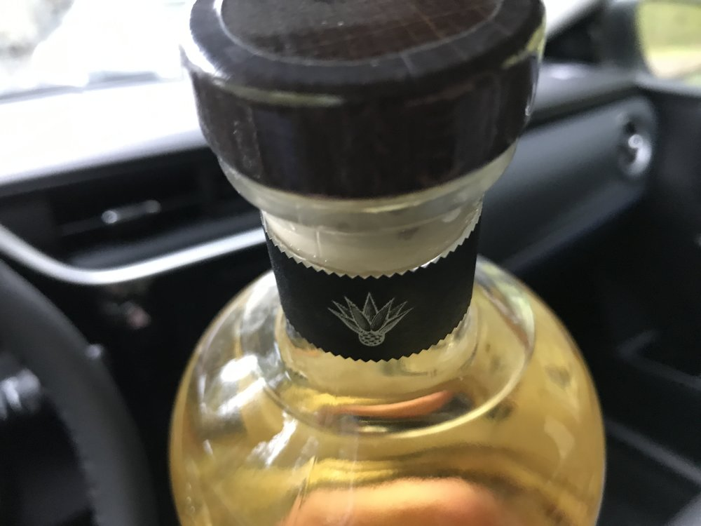 In a vehicle - You can have closed liquor anywhere in a vehicle (car, truck SUV, van)