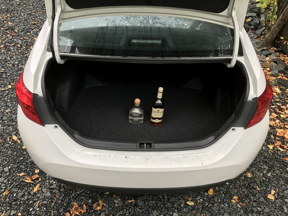 In a car - Store open liquor in the trunk (or rooftop carrier)