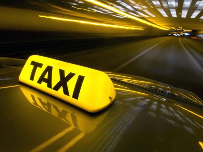 In a taxi - Taxi drivers cannot have any liquor and taxi passengers have to follow the normal rules for open or closed liquor