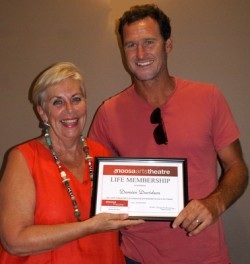 Damien recieveing his life membership at the Noosa Arts Theatre.
